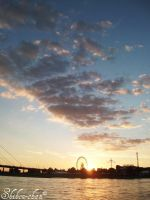 Sky above the Ferris wheel by ShihonRainbow