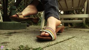 Dangling sandals and wiggling toes by JelisaRose-Feet