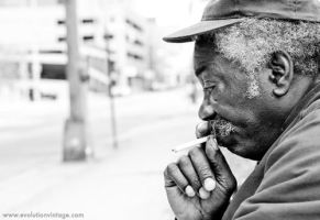 A Man With a Cigarette by evolutionsky
