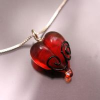 Scrolled Blood Heart Pendant by booga119