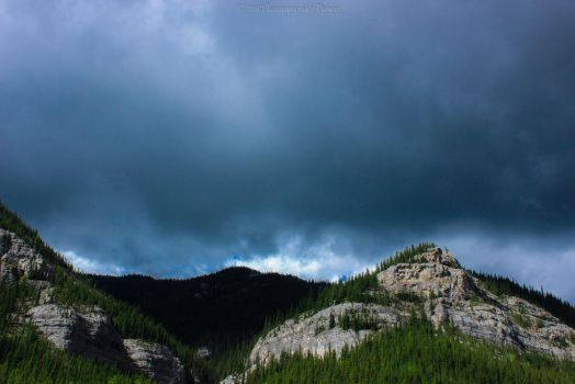Canyon Creek Ice Caves: Storm on the Horizon by Lumimyrskydawn