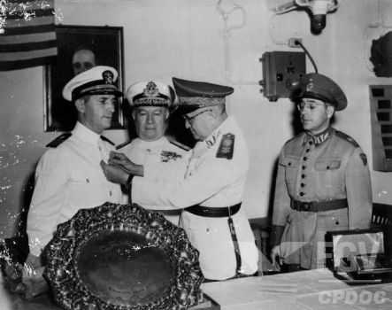 Officer of the american mission being condecorated by Gukpard