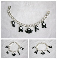 Pokemon Unown charm bracelet: LAURA